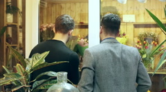 Men are choosing flowers for their girls. Holiday. March 8. Stock Footage