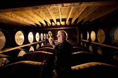 Worker testing whisky in distillery Stock Photos