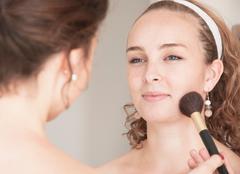 Teenage girl having her makeup done Stock Photos
