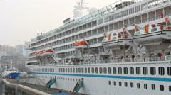 "Cruise liner ""ARTANIA"" in the port of Vladivostok - stock footage"