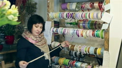 A lot of colorful satin ribbons are on the wall.  - stock footage