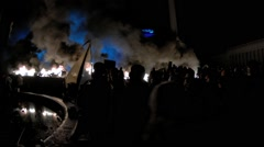 Kiev, Ukraine  February 19, 2014: Independant square. Protesters firing tires to Stock Footage