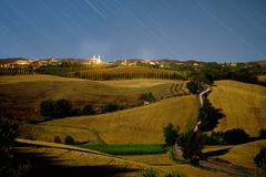 Time lapse of rural hills and night sky Stock Photos