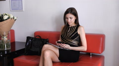 Stock Video Footage of Attractive young girl in black dress chatting on mobile phone, smiling
