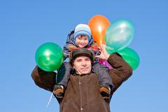 Grand-dad with a grandchild with air marbles Stock Photos