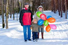 Grandmother, grand-dad and grandchild  on a walk Stock Photos