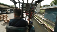 Male Operator Of An Electric Forklift Stock Footage