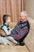 Grand-dad with a grandchild play Stock Photos
