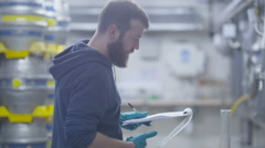 4K Worker in a brewery testing beer & checking quality of the product.  - stock footage