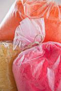 Close up of bags of pigment - stock photo