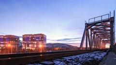 Evening view of the railway bridge in Ust-Kamenogorsk Stock Footage