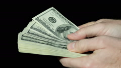 Male Hands Count Hundred Dollar Bills on Black Background Stock Footage