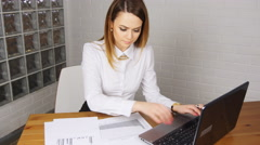 The girl working at the computer in the office Stock Footage