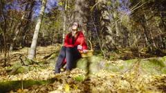 Woman in red coat sunbathing in forest 4K Stock Footage