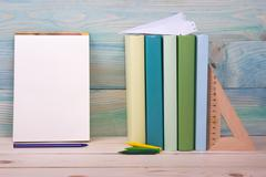 Back to school. Stack of colorful books on wooden table. Copy space - stock photo