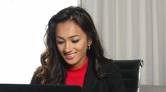 Stock Video Footage of Happy smiling ethnic Indian businesswoman working on laptop