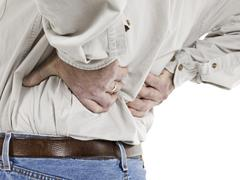 Close up image of aged man having back pain aga Kuvituskuvat