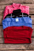 Stock Photo of Woman's pullovers of different color.