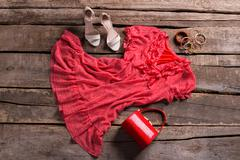 Dress and red cylinder purse. - stock photo