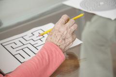 senior woman attempting a mental cognitive test - stock photo