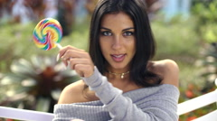 Female enjoying lollipop making video diary - stock footage