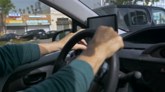 Hand held shot of a man driving and operating a GPS during the day Stock Footage