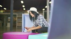 Hispanic girl on social media mall USA - stock footage