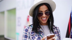 Female in mall networking on smart phone Stock Footage