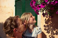 Mother and daughter admiring flowers Stock Photos