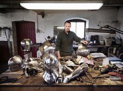 Stock Photo of Blacksmith with armor in shop
