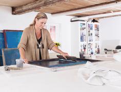 Designer printing on textiles in studio Stock Photos