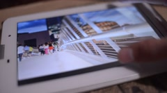 Viewing photose pictures on Digital Tablet - close-up Stock Footage