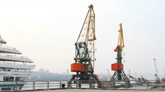 Harbor cranes at berth Stock Footage