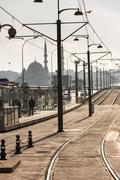 Tram tracks on bridge in Istanbul, a perspective look of detail metal rails - stock photo
