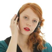 Young red haired woman with head set Stock Photos