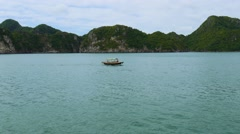 Small traditional vietnamese boat near shores of cat ba island, 4k Stock Footage