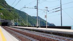Modern passenger train arriving to the station Corniglia Stock Footage