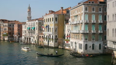 Gondolas and boats pass by on the Grand Canal in Venice, Italy Stock Footage