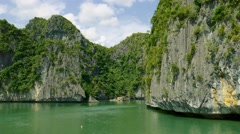 Fly along impressive carst limestone cliffs of ha long bay Vietnam Stock Footage