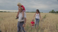 Family Walking On Farm Fourth of July Holiday - stock footage