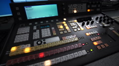 Shooting With a Panorama of the Telebroadcasting Console Lights in Dark Studio - stock footage