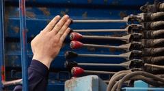 Crane Operator move Excavator control handlebars Stock Footage