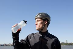 Man in cycling gear quenching thirst Stock Photos