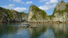 Floating fishing village in halong bay, Vietnam, Asia, view of limestone islands Stock Footage