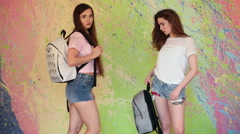 Beautiful young models in denim shorts - stock footage
