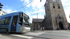 City Tram Makes a Sharp Turn. Wide Angle View - stock footage