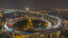 Night time lapse traffic driving over Nanpu bridge intersection Shanghai China - stock footage