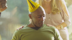 4K Happy man celebrates his birthday with a cake & generations of family - stock footage