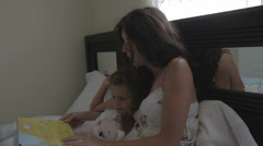 Mother Playing In Bed With Children Stock Footage