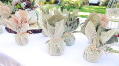 Several Small Gifts Packed in Burlap Bags Are on the Table. Wedding Decoration Stock Footage